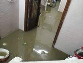 مياه الأمطار تحاصر أسرة كاملة فى عرب المعادى