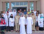ولى عهد دبي يتوسط كتيبة الأطباء المسئولة عن مواجهة تفشي كورونا بالإمارات