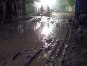 قارئ يطالب برصف شارع السوق بكفر غطاطى بالهرم حولته الأمطار إلى بركة طين
