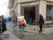 صور.. شباب بالعريش ينظمون حملة تعقيم مقرات شبابية وسيارات الأجرة
