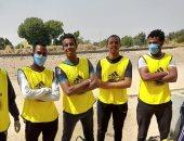 صور.. شباب منشية النوبة بالطود يطلقون مبادرة لتعقيم قريتهم ضد كورونا