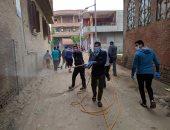 صور ..شباب قرية دجوى بالقليوبية يعقمون شوارعهم ضد كورونا