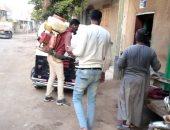 شباب عزبة بنى هلال بسوهاج يعقمون الشوارع والمنازل والشوادر ومحطة القطار