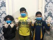 قارئ يشارك صورة ارتداء أولاده الجوانتى والكمامة للوقاية من فيروس كورونا