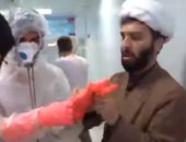 شاهد.. كيف يتم تغسيل جثامين ضحايا كورونا فى إيران.. يدفنهم متطوعين