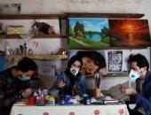 صور.. شباب غزة يبتكرون طريقة جديدة لمواجهة كورونا بالكمامات