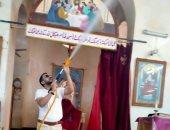 صور.. شباب مسلمون يطهرون الكنائس فى الصعيد لمواجهة كورونا