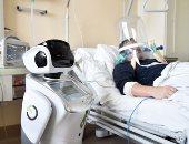 """مستشفيات إيطاليا تستخدم """"الروبوت"""" للمساعدة فى علاج مرضى فيروس كورونا"""