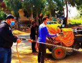 شباب قرية أبو السيد بالبحيرة يطهرون الشوارع لمكافحة فيروس كورونا