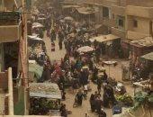 قارئ يشكو زحام المواطنين فى سوق عشوائى بقرية جزيرة محمد بالوراق