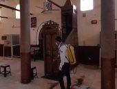 شباب الجمعية القبطية الأرثوذكسية يعقمون المساجد والمنشآت بالطود فى الأقصر.. صور