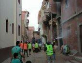 أهالى ههيا بالشرقية يطهرون الشوارع والمنازل للوقاية من فيروس كورونا