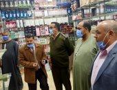 غلق وتشميع 5 محلات شمال بنى سويف لمخالفتها قرارات الحظر (صور)