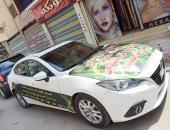 محام يحول سيارته إلى منصه متحركة لتوعية المواطنين بشوارع دمياط بخطورة كورونا