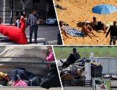 صور..العالم هذا الصباح.. سوريون يفرون من مخيمات أردوغان على حدود تركيا إلى إدلب خوفا من كورونا.. العالم يشدد إجراءات الحظر وأشخاص يخرجون للحدائق والشواطئ.. فوتوسيشن لعروسين فى شوارع ووهان بعد تراجع الوباء