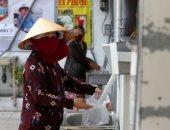 ابتكار ماكينة صراف آلى للأرز لإطعام الفقراء فى فيتنام لمواجهة تداعيات كورونا
