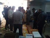 ضبط مخزن خمور مهربة بجراج فى القاهرة ومصادرة 1039 زجاجة.. صور