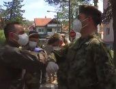 الدفاع الروسية تنشر فيديو لتطهير جنودها بمركز التدريب العسكرى فى صربيا