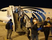 مطار مرسى علم يستقبل رحلة طيران لعالقين مصريين من بغداد تقل 155 راكبا