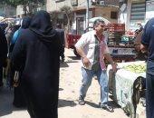 مركز طلخا بالدقهلية يفض سوق بقرية ديسط لمنع التجمعات .. صور