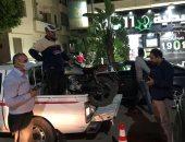 صور.. مصادرة دراجات نارية وصناديق دليفرى فى حملة بالدقى