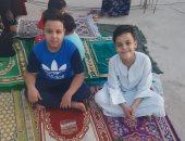 صور.. أهالى وأطفال الأقصر يحتفلون بعيد الفطر المبارك بالصلاة والبهجة فى المنازل