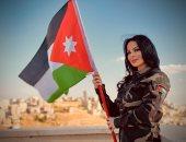 ديانا كرزون تحتفل بعيد الاستقلال فى الأردن بالزى العسكرى والعلم الوطنى