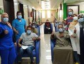 مستشفى إسنا للحجر الصحى تعلن خروج 20 مواطنا بعد شفائهم من كورونا.. صور
