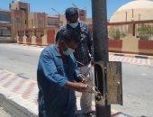 مجلس مدينة مرسى علم يواصل أعمال الصيانة الدورية لأعمدة الإنارة بالطرق