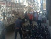 غلق منفذ لتوزيع أسطوانات الغاز مخالف بحى المناخ فى بورسعيد.. صور