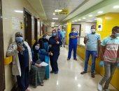 صور.. خروج 8 حالات بعد تعافيهم من فيروس كورونا بمستشفى إسنا للحجر الصحى