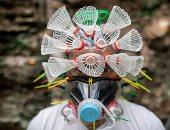 أقنعة وجه غريبة من مواد معاد تدويرها فى الفلبين لمكافحة كورونا.. صور