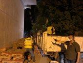 صور.. رئيس حى الدقى يقود حملات لتطهير الشوارع وفتح الجراجات المغلقة
