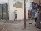 نقل عمود إنارة يتوسط أحد شوارع مدينة الحسينية لخطورته على الأهالى