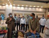 جمارك سفاجا: قدمنا كل التيسيرات لنقل وعودة 283 مصريا من السعودية.. صور