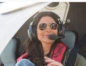 إليسا تنشر صورة قديمة من داخل طائرة: آمل أن أطير مرة أخرى وأغني لكم جميعا