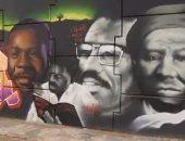 سنغاليون يرسمون لوحة جدارية ضخمة فى قلب دكار دعما لحقوق السود.. فيديو