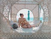 """بفستان عباد للشمس تحت أشعة الشمس.. نسرين طافش في رحلة شاطئية """"صورة"""""""