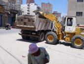 رفع تراكمات القمامة فى حملة نظافة صباحية بالمحلة
