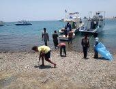 صور.. تنظيف شواطئ مرسى علم لليوم الثانى على التوالى
