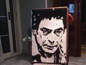 """""""شريف"""" فنان يرسم الكينج بالخيط فى لوحة ويحول قطعة خشب لشريط كاست"""