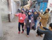 أهالى الحسينية بمحافظ الشرقية يطهرون الشوارع ضد فيروس كورونا
