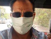 """""""صابر"""" من أسيوط يشارك صورته بالكمامة التزاما بالإجراءات الوقائية"""