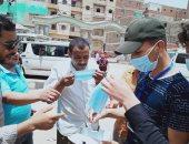 """""""إرادة شعب الشرقية"""" توزع 12 ألف ملصق للتوعية و كمامات مجانا.. صور"""