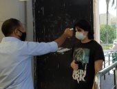 كشف حرارة ومنع دخول الطلاب بدون كمامة على بوابات جامعة عين شمس