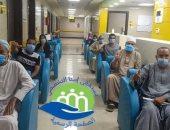 صور.. مستشفى إسنا للحجر الصحى تعلن خروج 15 حالة تعافى من فيروس كورونا