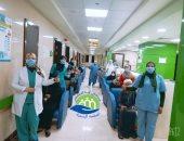 صور.. خروج 14 حالة شفاء من فيروس كورونا بمستشفى إسنا للحجر الصحى