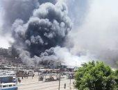 شاهد.. آثار حريق محلات وأكشاك سوق توشكى بحلوان واستمرار عمليات التبريد