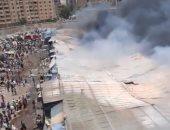 المباحث تسمتع لأقوال شهود العيان وأصحاب محلات حريق سوق حلوان