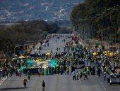 باتمان و الصليب فى مظاهرات دعم لرئيس البرازيل ضد المعارضة